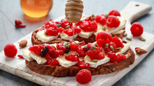 Raspberry And Brie Sourdough Bread Toast With Pumpkin Seeds And Drizzled With Honey