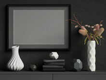 Mock Up Picture Frame On Black Plaster Wall With White Ceramic Vase With Flowers, Books And Geometric Pots; Stylish Poster Frame Dark Background; Landscape Orientation; 3d Rendering, 3d Illustration