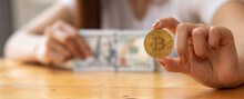 Woman Hand Holding Bitcoin And Dollars