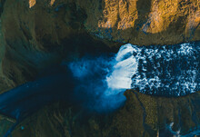 Ocean Waves Hitting Brown Rock Formation