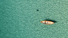 Brown And White Boat On Water