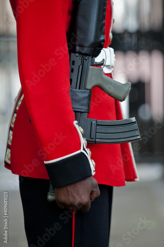 Fototapeta British army guard in red tunic and bearskin on parade at the Trooping of the Co