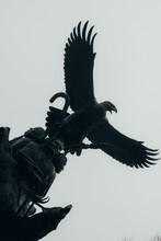 Low Angle Shot Of An Eagle Statue Against The Cloudy Sky
