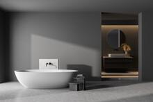 Modern Bathroom Interior With Dark Concrete Walls, Gray Floor, White Bathtub And Sink. 3d Rendering