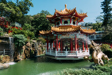 Golden Dragon Water Fountain With Pond And Buddhist Gazebo In Taipei Taiwan