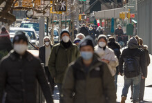 Crowd Of People Walking Street Wearing Masks