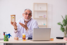 Old Male Dentist In Time Management Concept