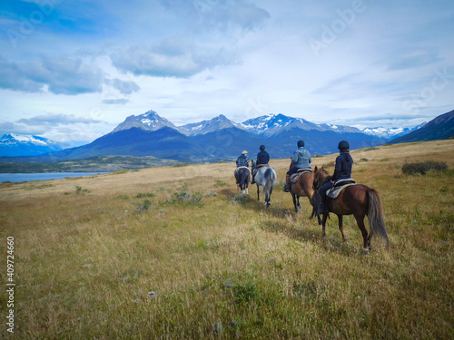 Valokuvatapetti Four pepope enyojing to horse riding in Patagonia, Torres del Paine national park, near the lago Sophia, Puerto Natales