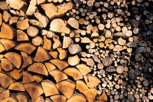 Interesting Reddish Brown Wood Pile In Evening Sunlight With Different Cut Wood, Close Up View, Without People, During Daytime