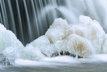 Winter Landscape Of The Rabbit River Cascade Captured With Motion Blur And Framed In Ice, Michigan, USA