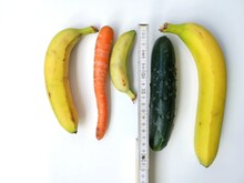 Measuring Tape With Bananas, Carrot An Cucumber Symbolizing Different Penis Sizes And Forms