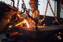 Process Of Pouring Hot Molten Steel In Foundry. Metallurgy Process And Steel Production.