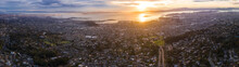 The Sun Sets Over The San Francisco Bay Area In California. This Heavily Populated Region Includes The Cities Of San Francisco, Oakland, Berkeley, Emeryville, El Cerrito, Richmond, And More.