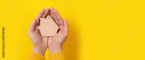 Obraz house toy in hands over yellow background, panoramic mock-up - fototapety do salonu