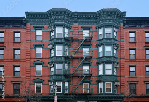 Fototapeta Old New York apartment building with external fire escape