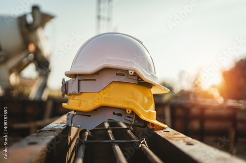 Obraz white and yellow helmet on steel in construction site - fototapety do salonu