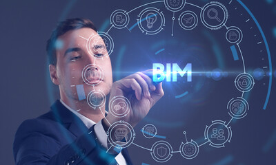 Business, Technology, Internet and network concept. Young businessman working on a virtual screen of the future and sees the inscription: BIM