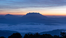 Mountain And Sea Of Fog Sunrise Surrounded With Mountain And Forest At Huai Nam Dang National Park Chiang Mai, Thailand