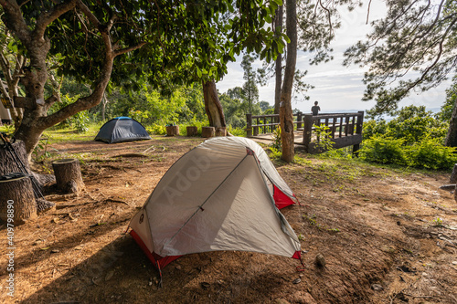 Fotografering The camping tent on the mountain with sky and tree surrounded