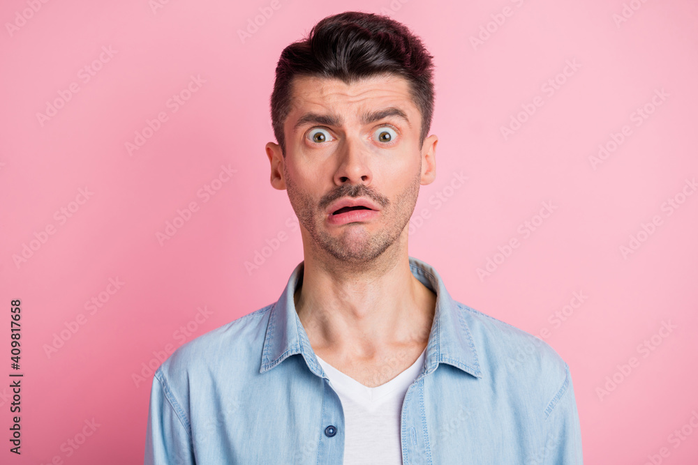 Fototapeta Photo portrait of nervous stressed man staring lost forgot worried frustrated isolated pastel pink color background