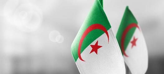 National flag of the Algeria on dark fabric