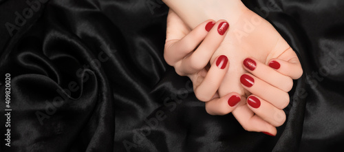 Fotografie, Obraz Female hands with red nail design