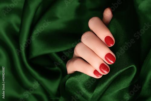 Fototapeta Female hand with red nail design