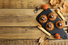 Delicious Cookies Decorated As Monsters On Wooden Table, Flat Lay With Space For Text. Halloween Treat