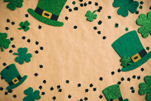 St Patrick's Day Banner Design. Irish Leprechaun Hats And Shamrock Clover Leaves On Kraft Paper Background With Copy Space. Happy Saint Patricks Day Concept. Flat Lay, Top View.