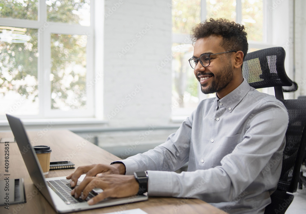 Fototapeta Confident businessman working on laptop at his workplace at modern office, Young handsome student men using laptop computer, Business, working moments, freelance, distance education concept