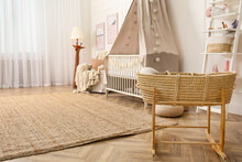Baby Room Interior With Toys And Stylish Furniture