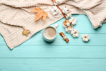 Flat Lay Composition With Coffee And Warm Plaid On Turquoise Wooden Table, Space For Text