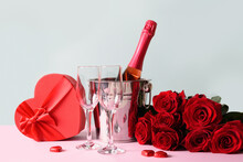 Valentine's Day Heart Gift Greeting Card With Gift And Red Sparkling Wine On Blue. Banner With Copy Space.