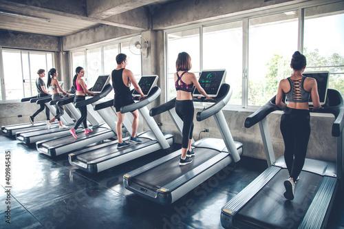 Obraz People jogging on treadmills. - fototapety do salonu
