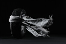 Winter Tire With Grey Scarf On Black Background