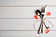 Cutlery Set And Pink Ribbon On White Table, Top View With Space For Text. Valentine's Day Romantic Dinner