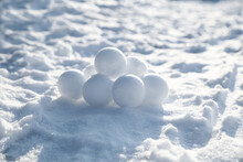 Pile Of Snowballs Outdoors On Sunny Winter Day