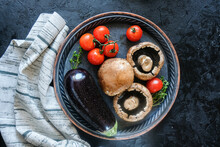 Fresh Grow Mushrooms And Fresh Vegetables - Fresh Vegetables-zucchini,tomatoes,eggplant, Onions, Tomatoes On Wooden Rustic Table Viewed From Above. Rustic. Ingredients For Vegan, Who, Paleodieta.