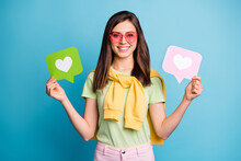 Photo Of Young Lovely Pretty Attractive Happy Smiling Girl In Funky Glasses Hold Heart Icons Isolated On Blue Color Background