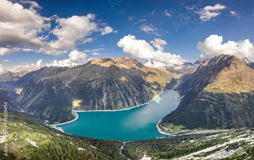 Fotografering Aerial drone shot of Schlegeisspeicher glacier reservoir in zillertal alps in Au