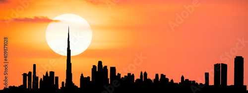 Fototapety, obrazy: Stunning view of the silhouette of the Dubai skyline during a beautiful and dramatic sunset. Photorealistic image of the Dubai Cityscape.