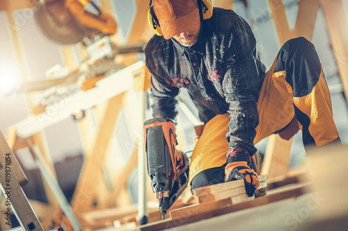 Obraz Construction Worker with Nail Gun in His Hand - fototapety do salonu