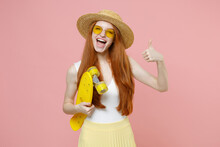 Young Redhead Happy Energetic Ginger Teenager Student Woman 20s Wearing Straw Hat Glasses Summer Clothes Holding Skateboard Show Thumb Up Gesture Isolated On Pastel Pink Background Studio Portrait.