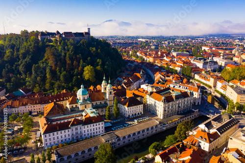 Fototapeta Aerial view of Slovenian town of Ljubljana overlooking fortified castle on hill