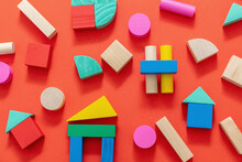 Wooden Colorful Blocks On Red Color Background