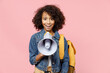 Smiling leader little african american kid school girl 12-13 years old in casual denim clothes with backpack scream in megaphone isolated on pastel pink background studio Childhood education concept.