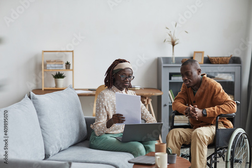 Obraz na plátně Portrait of African-American couple with handicapped man working from home toget