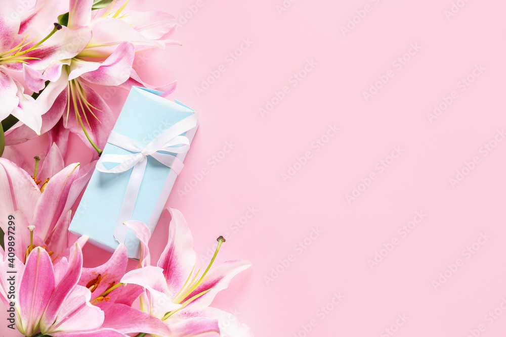 Fototapeta Beautiful lilies and gift on color background