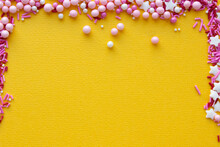 Decorations For Pastry On Yellow Background