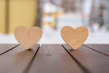 Valentine's Day, Two White Hearts Stand On A Wooden Brown Surface